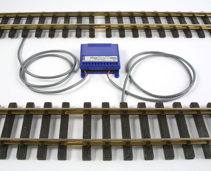The Massoth ME_8170001 Feedback Module with two track contacts placed under the tracks